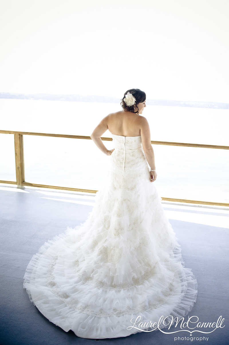 Bride in wedding gown overlooking Puget Sound.