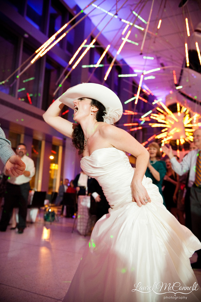Bride having a blast at wedding reception.