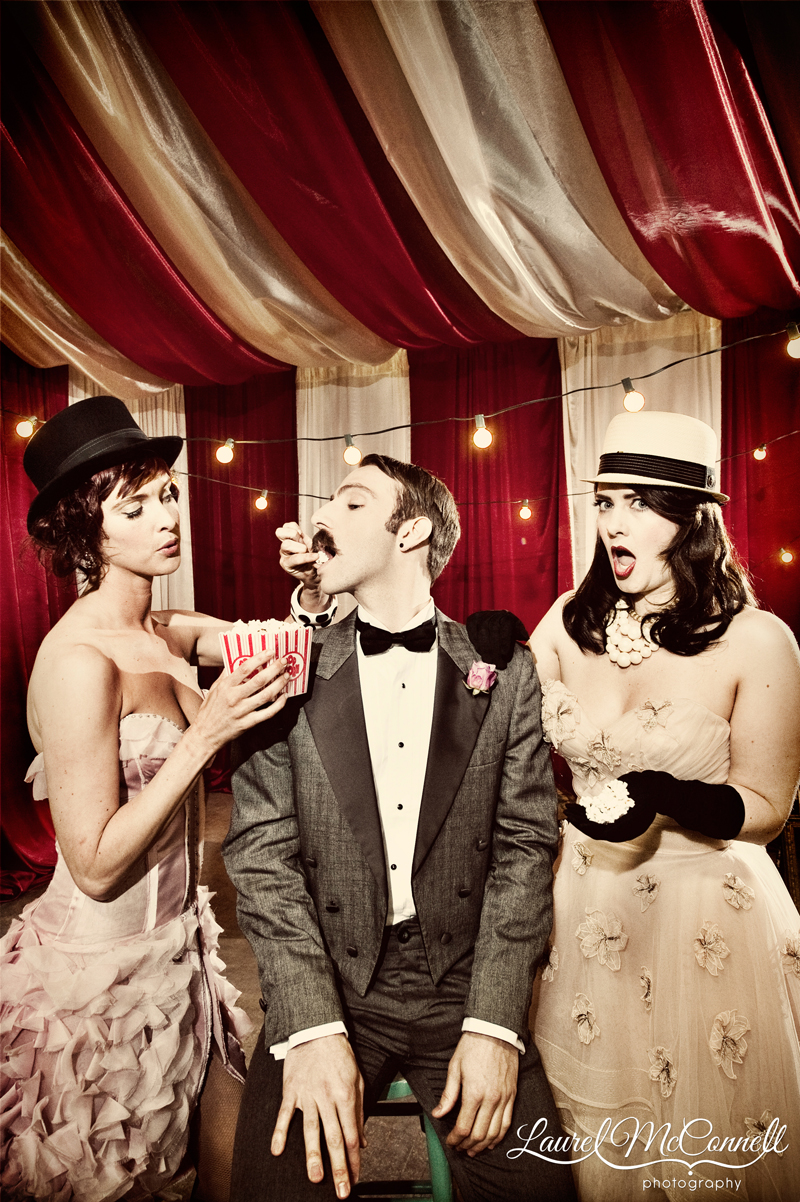 Hilarious wedding editorial style red and white tent portrait.