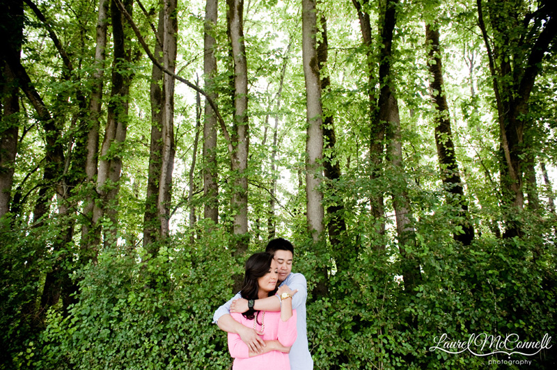 Engagement photo of couple in woods in Woodinville, WA winery.