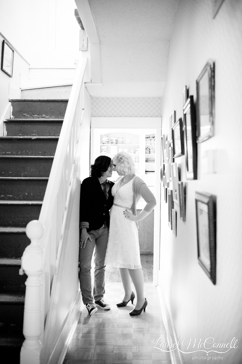 Sweet black and white bridal portrait of lesbians in a farm house
