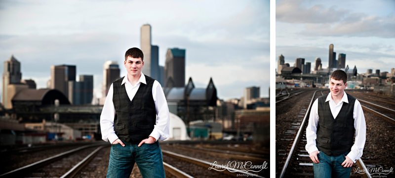 Senior session on train tracks in Seattle Sodo neighborhood with skyline behind by photographer Laurel McConnell.