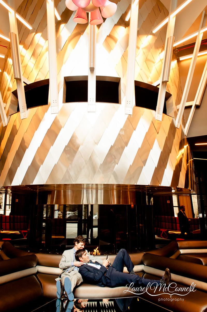 Grooms lounge in the lobby of the W Hotel in Seattle Washington, by same sex wedding photographer Laurel McConnell.