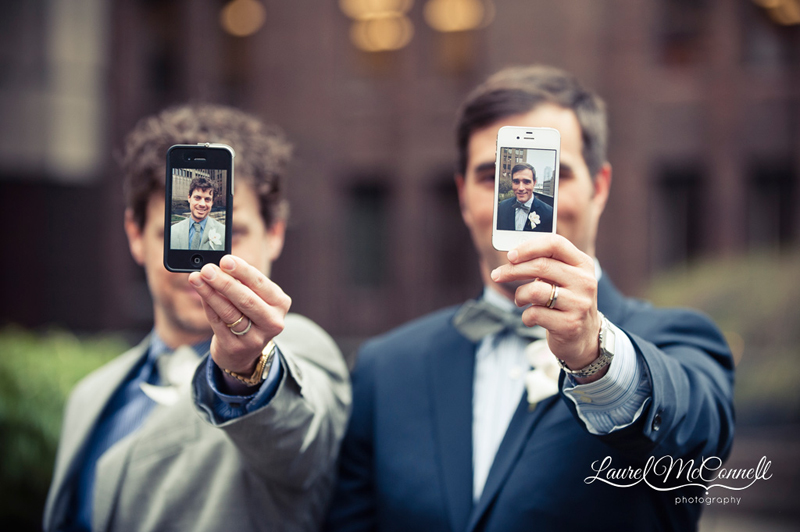 Creative, silly wedding portrait of grooms and their iPhones, by marriage equality Seattle photographer Laurel McConnell.