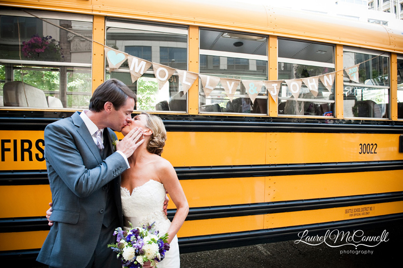 Bride and groom in front of yellow school bus by Seattle Photographer Laurel McConnell.