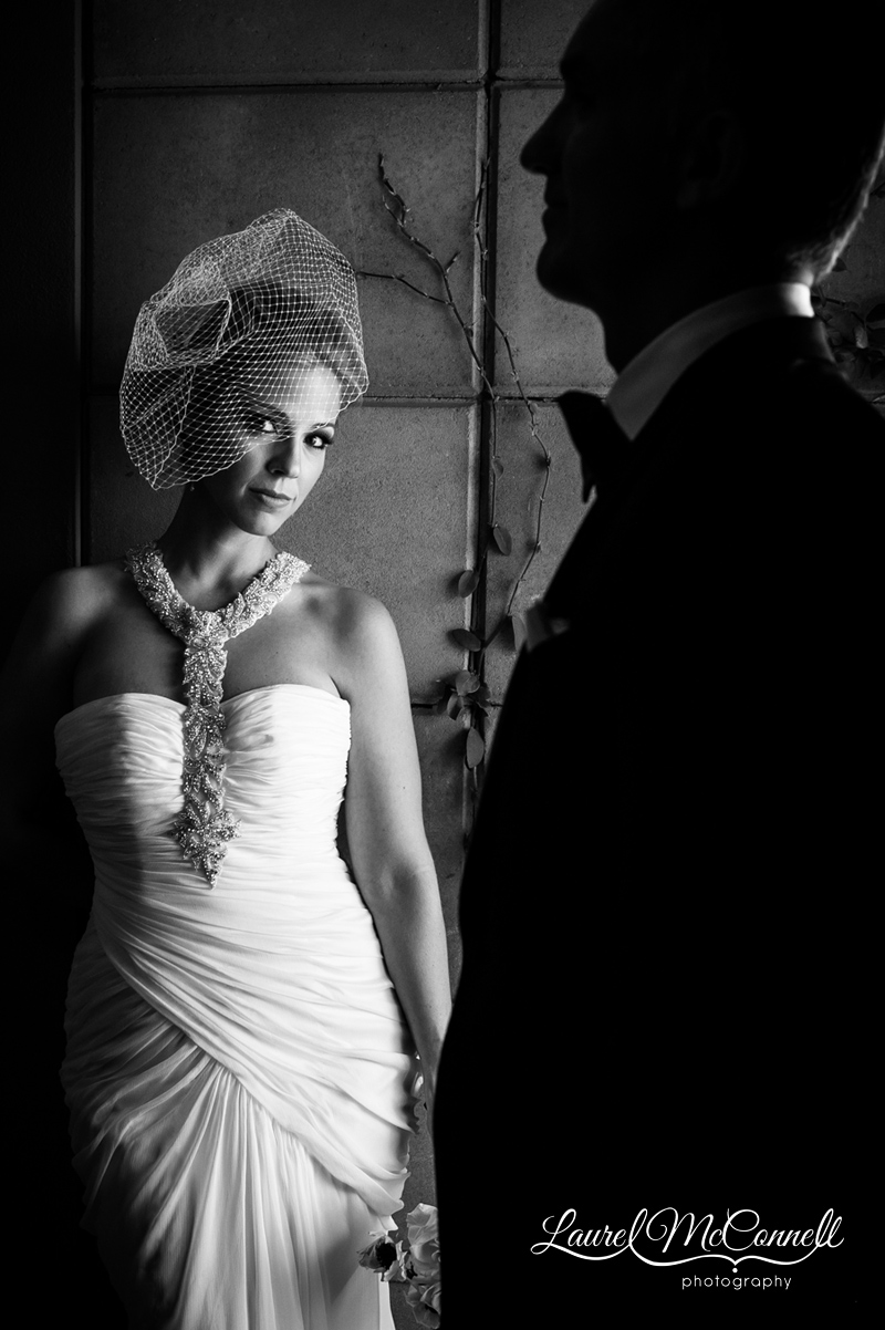 dramatic black and white bridal portrait of the bride and groom