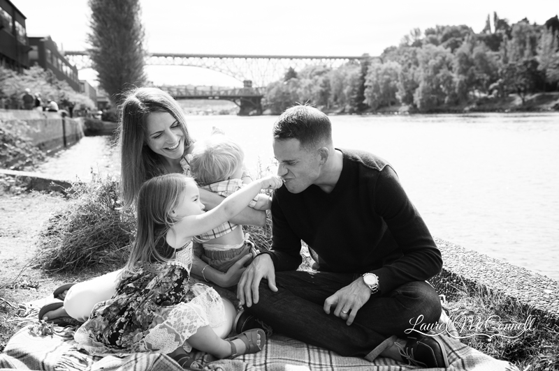 Playful black and white portrait of family near the water in Fremont, Washington photographed by Laurel McConnell Photography.