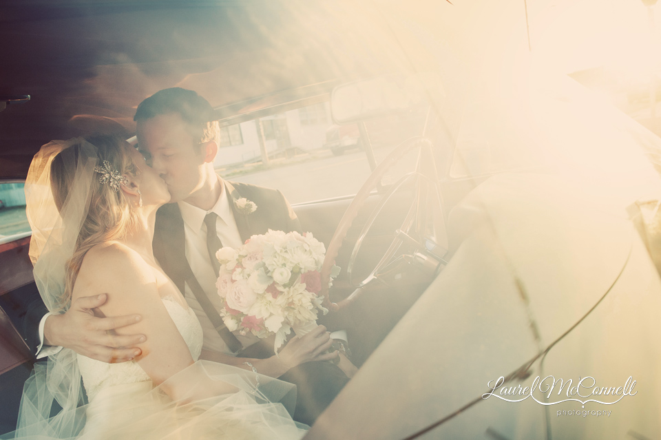 classic car cadillac with bride and groom in seattle sodo district