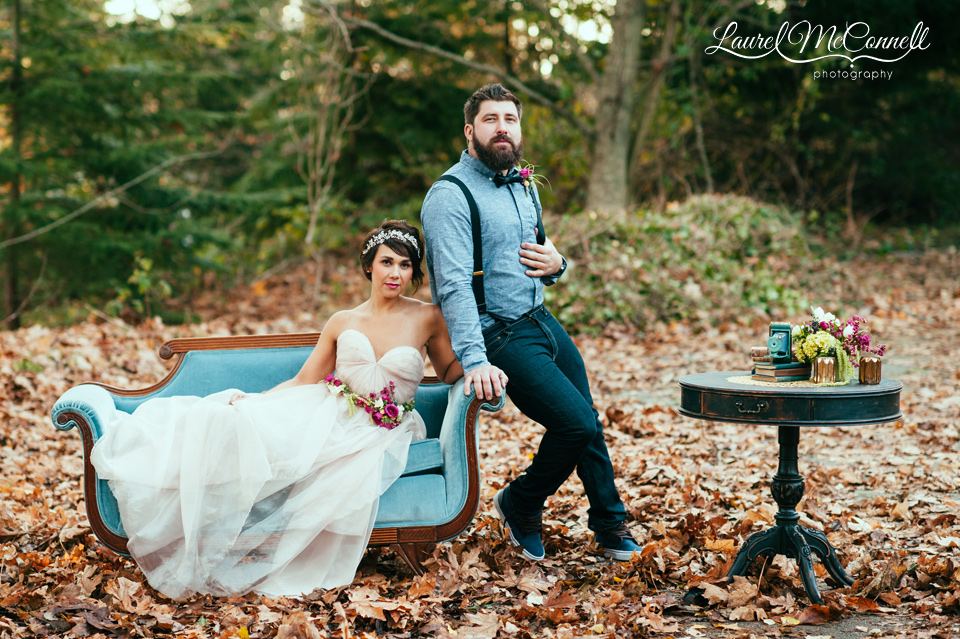 bridal fashion shoot in the woods vintage teal couch blush wedding gown