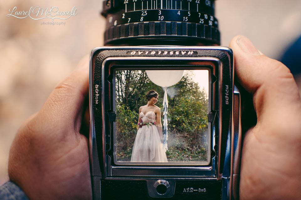bride in viewfiender of vintage camera