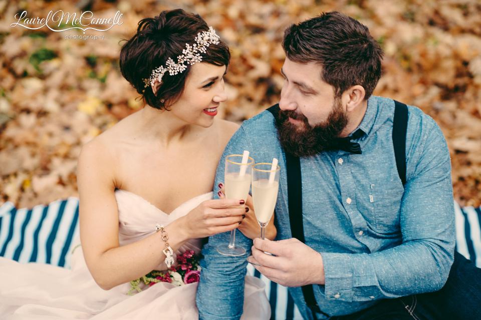 bride groom picnic toasting