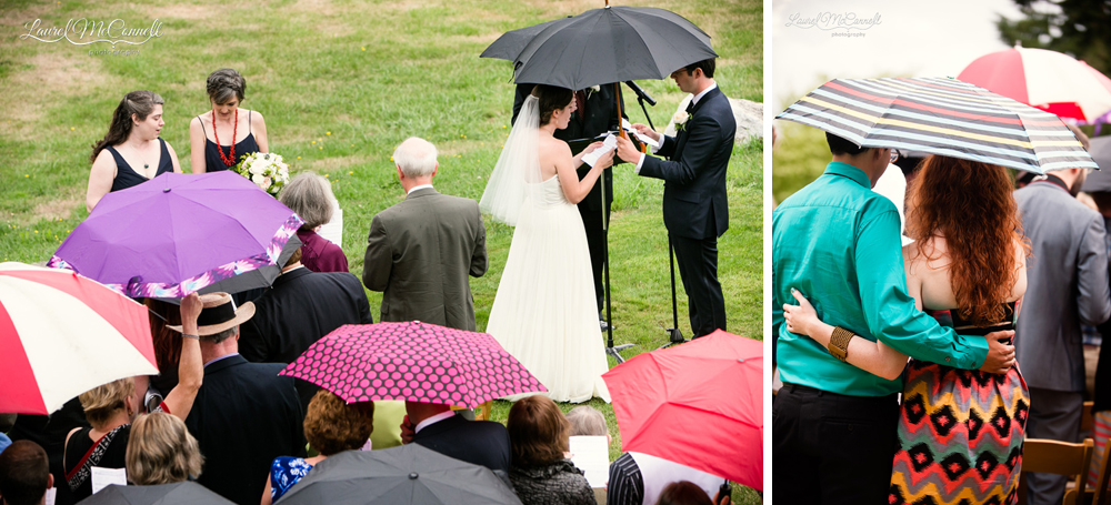 Guests watch wedding under umbrellas.