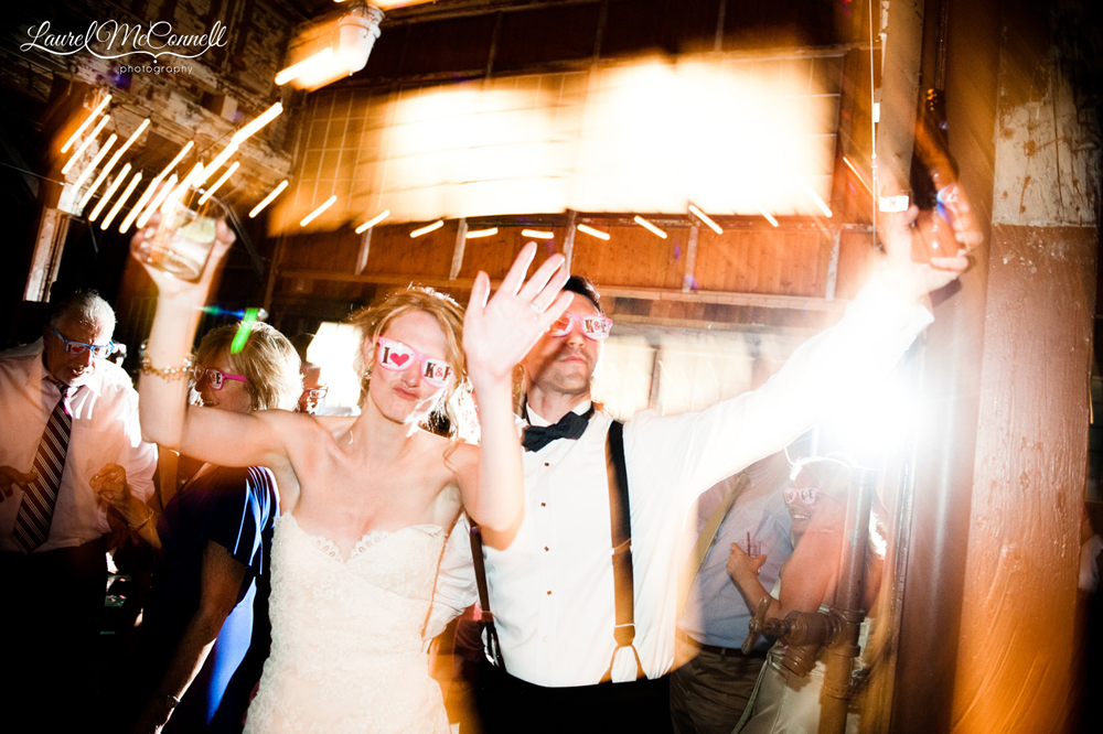 Natural, wacky bride and groom dancing portrait.