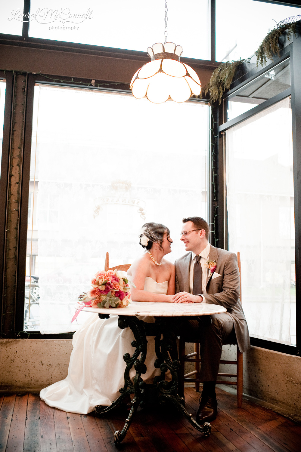Rainy day wedding portrait in restaurant.