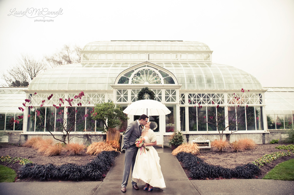 Sweet wedding day portrait under umbrella.
