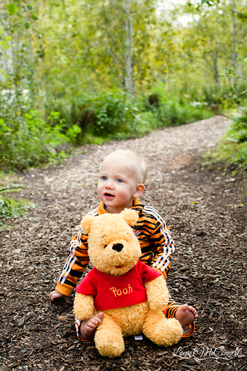 Sweet, sweet portrait of baby dressed as tiger with Winnie the Pooh.