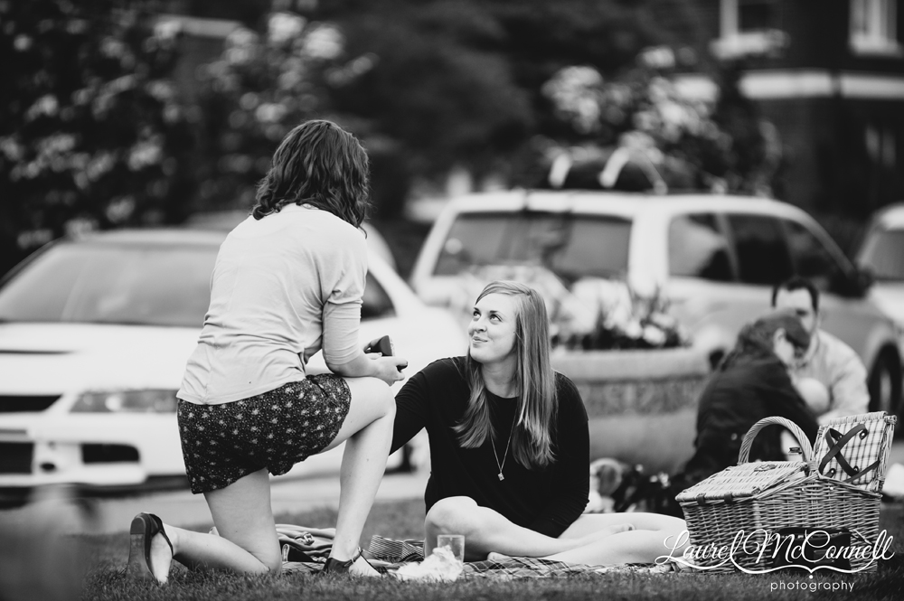 Woman proposes to her girlfriend at Kerry Park in Seattle, Washington.