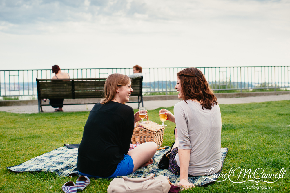 Adorable couple toast their engagement overlooking the Puget Sound.
