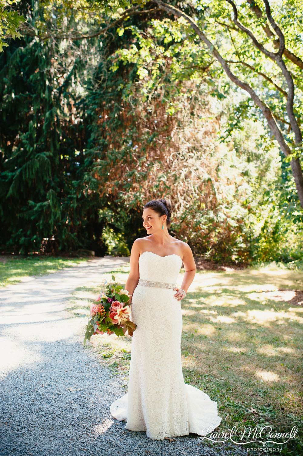 Romantic, wooded Seattle bridal portrait in Amy Kuschel gown by Laurel McConnell Photography.