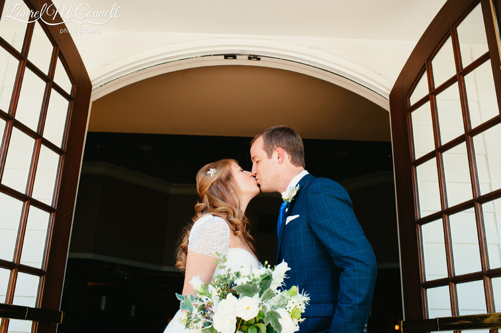 Sweet bride and groom portrait at Woodinville's Columbia Winery photographed by Laurel McConnell Photography.