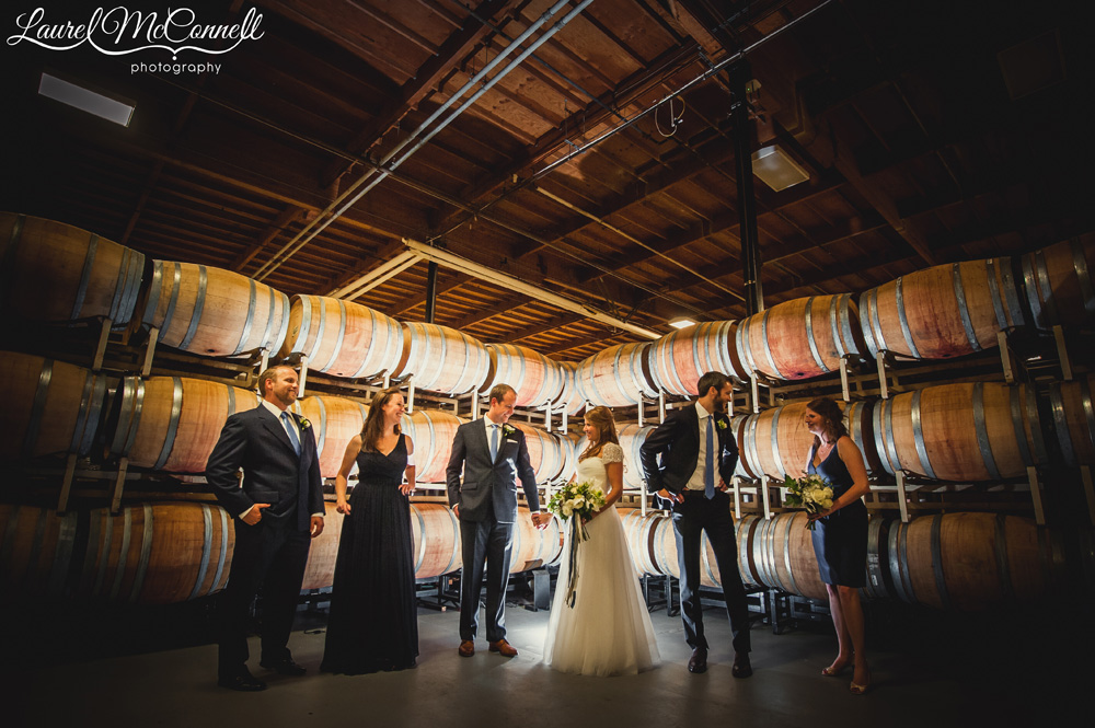 Wine barrel cellar wedding party portrait at Woodinville's Columbia Winery photographed by Laurel McConnell Photography.
