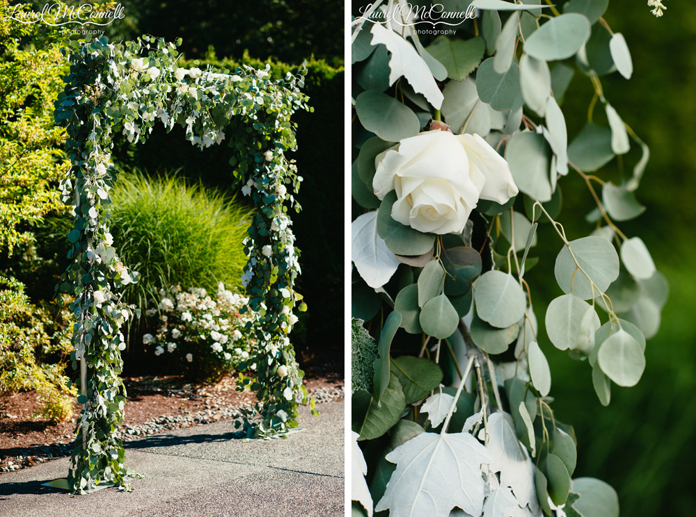 Sage and white wedding ceremony arch created with roses and greenery by Stacy Anderson photographed by Laurel McConnell Photography.