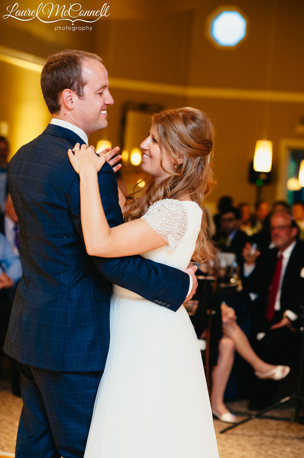 Lovely portrait of bride and groom's first dance at Columbia Winery wedding reception photographed by Laurel McConnell Photography.