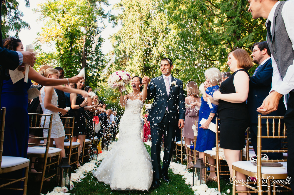 Fun, confetti exit at Seattle winery wedding photographed by Laurel McConnell Photography.