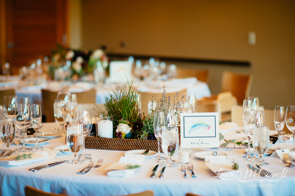 Outdoosy, fly-fishing inspired, grass and plant centerpieces with handpainted lure table markers photographed by Laurel McConnell Photography.