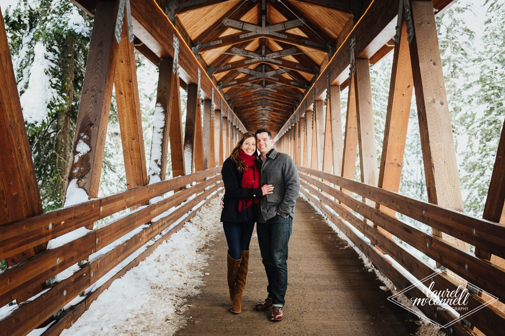 couple_hugging_in_covered_bridge