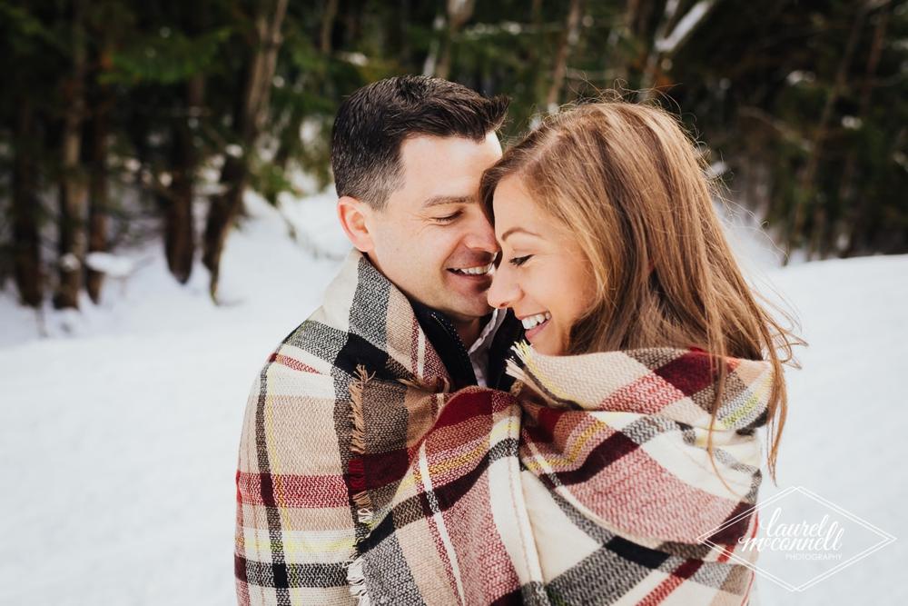 couple_hugging_under_plaid_blanket